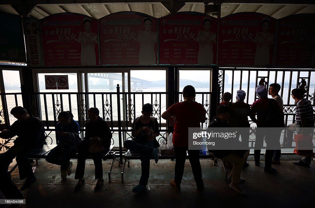 Passengers wait for a ferry to cross the Chang Jiang river in Wuhan, China, on Sunday, Oct. 20, 2013. China's economic expansion accelerated to 7.8 percent in the third quarter from a year earlier, the statistics bureau said Oct. 18, reversing a slowdown that put the government at risk of missing its 7.5 percent growth target for 2013. Photographer: Tomohiro Ohsumi/Bloomberg via Getty Images