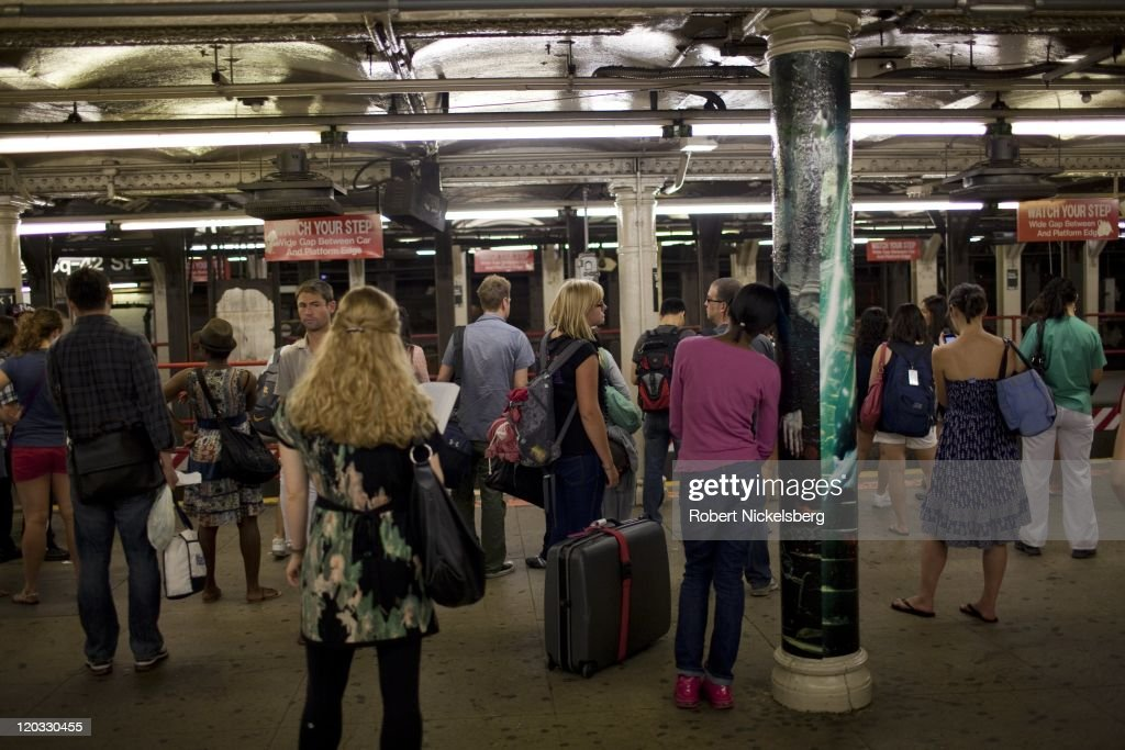 Passengers wait for a subway at 42nd Street to Grand Central Station July 31, 2011 in the Manhattan borough of New York.