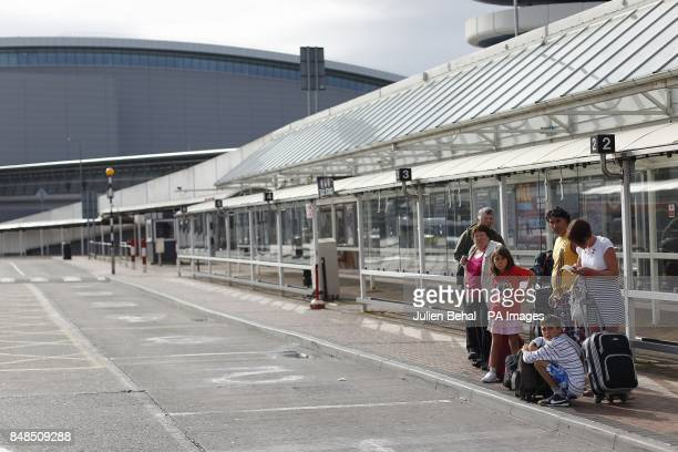 Passengers wait for a Taxi at an empty rank in Dublin Airport as a taxi strike at Dublin Airport is in its second day as authorities returned 30 out...