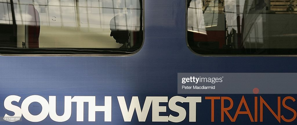 Passengers wait for a train to depart from Waterloo railway station on August 29 2006 in London England South West Trains say that only 10% of their...