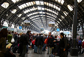 Passengers wait for a train to depart to Rome at Milano Centrale train station on April 19 2010 in Milan Italy Passengers are looking for alternative...