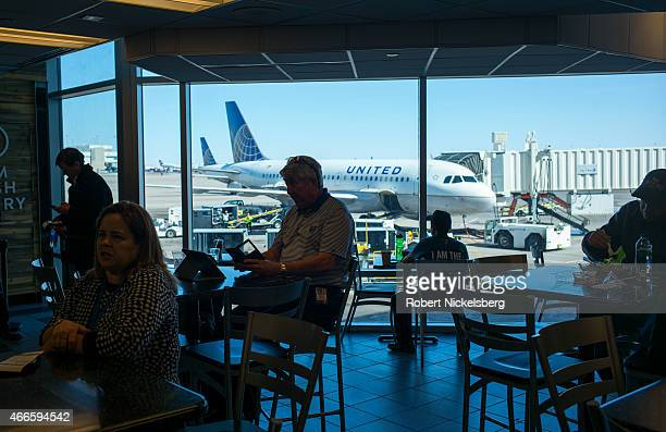Passengers wait for a United Airlines flight March 6 2015 at the Denver International Airport in Denver Colorado