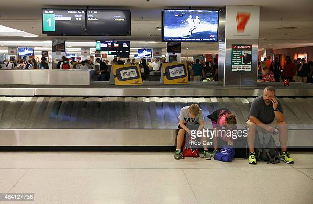 Passengers wait for bags at the Southwest Airlines baggage claim at Baltimore/Washington International Thurgood Marshall Airport as flights are...