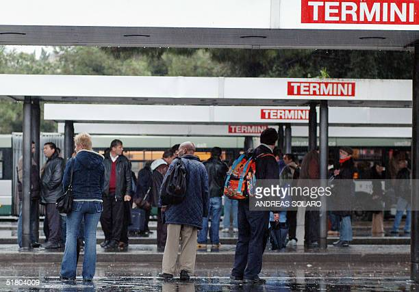 Passengers wait for buses at a bus station in Rome 30 November 2004 as millions of workers across Italy observed a general strike in protest against...