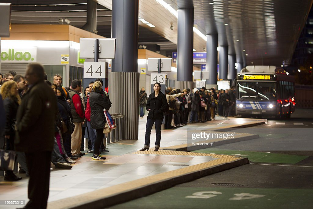 Passengers wait for buses at the Empresa Municipal de Transportes de Madrid (EMT) depot on the morning of a general strike in Madrid, Spain, on Wednesday, Nov. 14, 2012. Spanish unions today staged their second general strike against Prime Minister Mariano Rajoy as mounting opposition to budget cuts and bank bailouts undermines the 11-month-old government's ability to repair the economy. Photographer: Angel Navarrete/Bloomberg via Getty Images