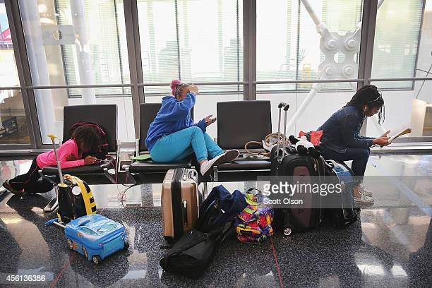Passengers wait for flights at O'Hare International Airport's on September 26 2014 in Chicago Illinois All flights in and out of Chicago's O'Hare and...