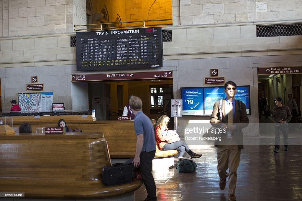 Passengers wait for Metro North or Amtrak trains November 11, 2012 in New Haven, Connecticut.