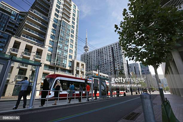 Passengers Wait for Streetcar on Queens Quay, Harbourfront, Toronto, Canada