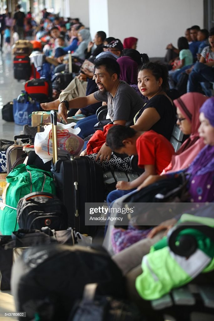 Passengers wait for the train to depart from their hometown, ahead of the Muslim Eid al-Fitr holiday, at Pasar Senen train station in Jakarta, Indonesia on June 30, 2016. Millions of people back to their hometown from Indonesia' s capital Jakarta to celebrate Eid-al-Fitr with their families and marking the end of the holy month of Ramadan.