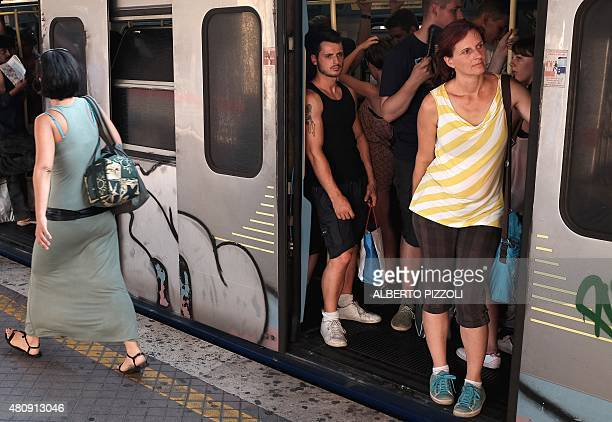 Passengers wait for the train to leave at a Rome subway station on July 15 2015 For the past several days the Rome subway timetable has been hit with...