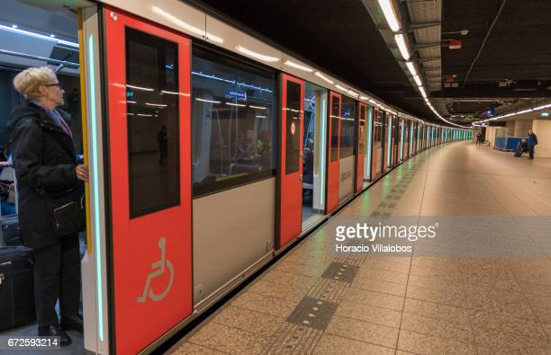 Passengers wait for the train to move at Metro Central Station on April 22 2017 in Amsterdam Netherlands The city's Metro system was first introduced...