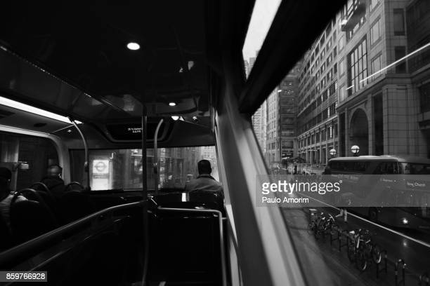 Passengers wait for their destinations on the bus in London