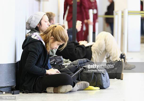 Passengers wait for their flights at Tegel airport on January 6 2011 in Berlin Germany Sudden freezing rain causing traffic chaos on highways and...