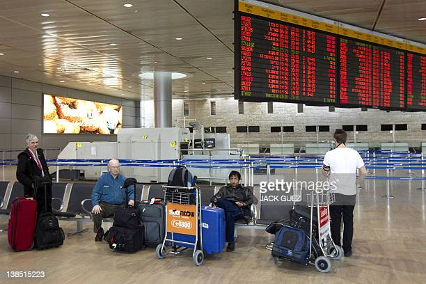 Passengers wait for their flights during a sixhour strike at the Ben Gurion Airport near Tel Aviv on Febuary 8 2012 Half a million Israeli public and...