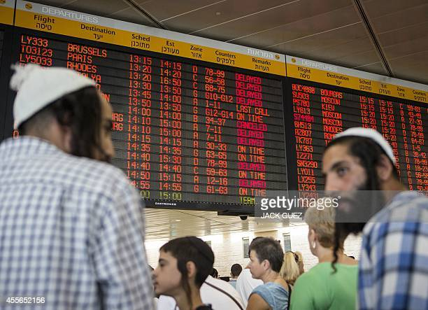 Passengers wait for their flights during a threehour strike at Israel's Ben Gurion Airport near the coastal city of Tel Aviv on September 18 2014...