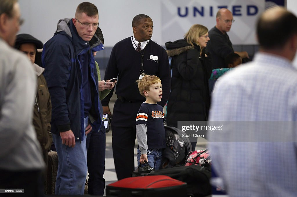 Passengers wait for their luggage after arriving at O'Hare Airport on November 21, 2012 in Chicago, Illinois. The Chicago Department of Aviation anticipates nearly 1.8 million passengers will travel through Chicago's two airports for the Thanksgiving holiday travel period between Tuesday, November 20 and Tuesday November 27.