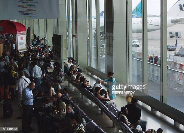 Passengers wait for their plane at Orly Paris airport on August 1 2008 on the first day of a crowded travel weekend as July and August tourists cross...