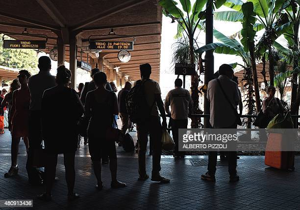 Passengers wait for their train at a Rome subway station on July 15 2015 For the past several days the Rome subway timetable has been hit with delays...