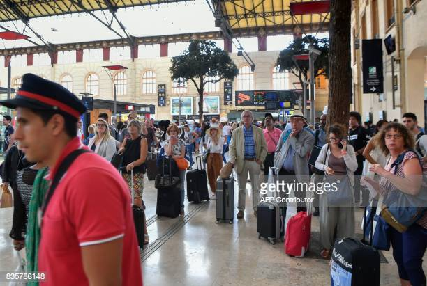 Passengers wait for their trains at The SaintCharles Station in Marseille on August 20 following a fire between Aubagne and Carnoux southeastern...