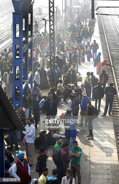 Passengers wait for their trains to arrive at the New Delhi Railway Station as security across the capital was beefed up after authorities received a...