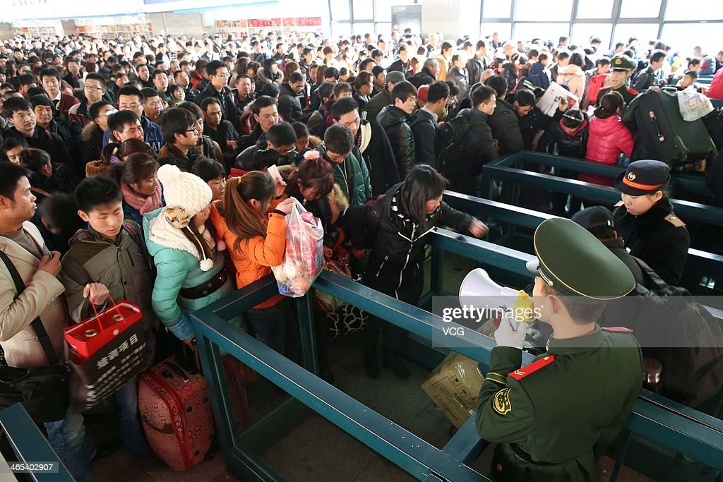Passengers wait for trains at Beijing West Railway Station on January 26, 2014 in Beijing, China. The Chinese Spring Festival travel rush began on January 16 and about 3.62 billion passenger trips are expected to be made across the country, with around 257 million train trips during the 40-day lunar New Year travel period.