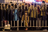 Passengers wait for trains at Guangzhou Railway Station as they travel for the upcoming Spring Festival on February 2 2016 in Guangzhou Guangdong...