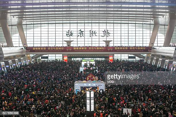 Passengers wait for trains at Hangzhou East Railway Station as they head back home for the upcoming Spring Festival on February 1 2016 in Hangzhou...