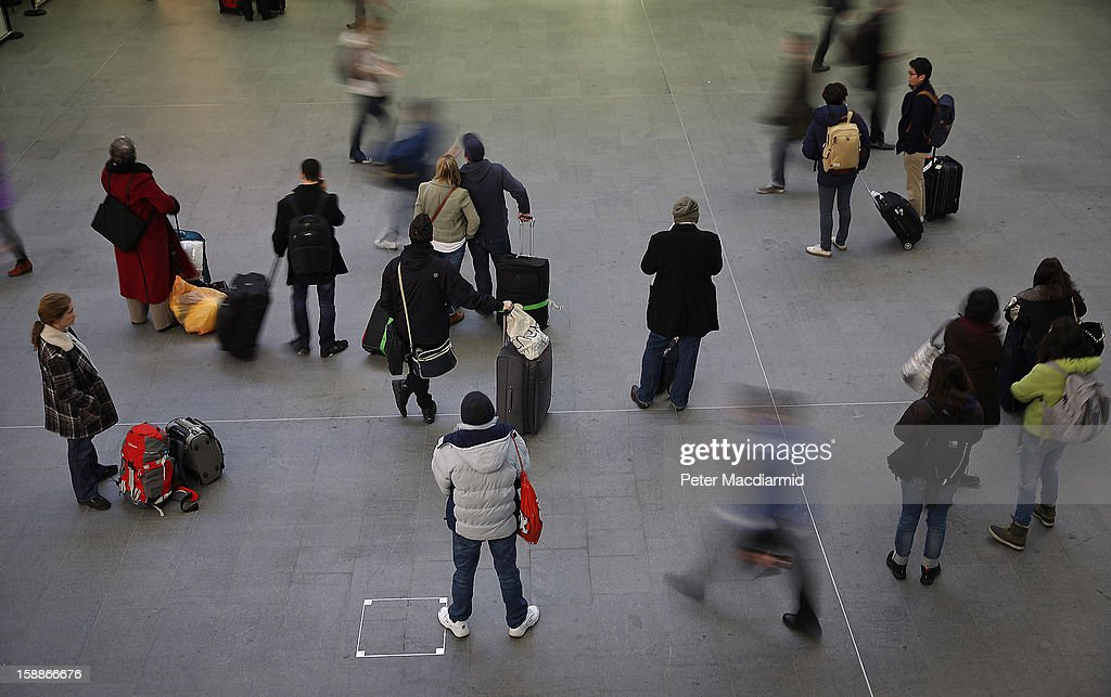 Passengers wait for trains at Kings Cross station on January 2, 2013 in London, England. Rail fares have today risen by an average of 4.2% in England, Scotland and Wales, the tenth year in a row that fares have increased above inflation.