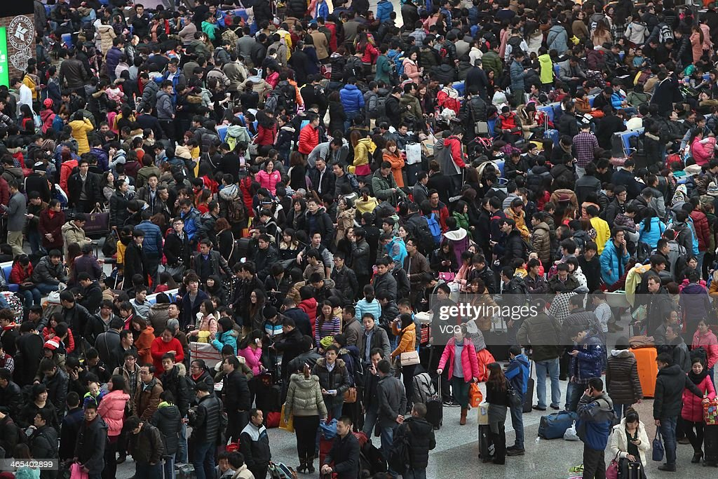 Passengers wait for trains at Shanghai Hongqiao Railway Station on January 26, 2014 in Shanghai, China. The Chinese Spring Festival travel rush began on January 16 and about 3.62 billion passenger trips are expected to be made across the country, with around 257 million train trips during the 40-day lunar New Year travel period.