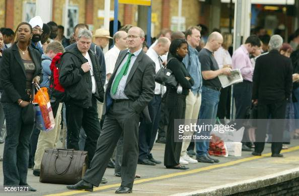 Passengers wait for trains to arrive during rush hour at Clapham Junction on May 20 2004 in London England Railway workers have voted to strike in a...