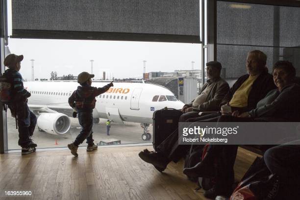 Passengers wait in a departure lounge at the Oslo Airport Gardermoen March 9 2013 in Oslo Norway Gardermoen is the main domestic hub and...