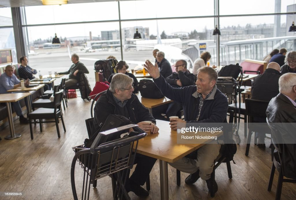 Passengers wait in a departure lounge restaurant at the Oslo Airport Gardermoen March 9, 2013 in Oslo, Norway. Gardermoen is the main domestic hub and international airport for Norway.