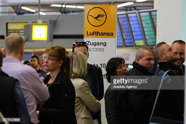 Passengers wait in a long line for the Lufthansa counter at the Tegel airport on October 20 2014 in Berlin Germany Lufthansa pilots belonging to the...