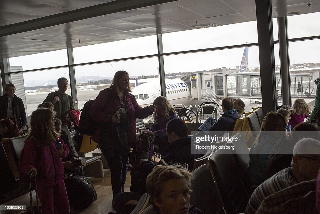 Passengers wait in a United Airl Lines departure lounge at the Oslo Airport Gardermoen March 9, 2013 in Oslo, Norway. Gardermoen is the main domestic hub and international airport for Norway.