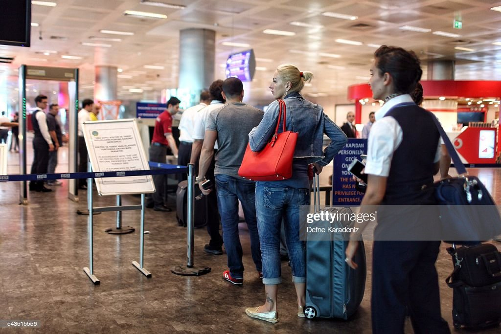 Passengers wait in line in front of an x-ray machine at a security check point at Turkey's largest airport, Istanbul Ataturk, following yesterday's blasts June 29, 2016, Turkey. Three suicide bombers opened fire before blowing themselves up at the entrance to the main international airport in Istanbul, killing at least 36 people and wounding 147 people according to PM Binali Yildirim.
