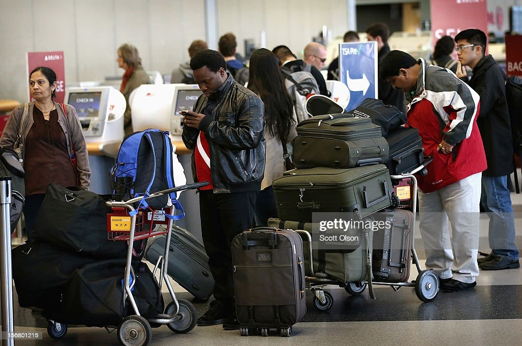 Passengers wait in line to check in for their flights at O'Hare International Airport on November 21, 2012 in Chicago, Illinois. The Chicago Department of Aviation anticipates nearly 1.8 million passengers will travel through Chicago's two airports for the Thanksgiving holiday travel period between Tuesday, November 20 and Tuesday November 27.