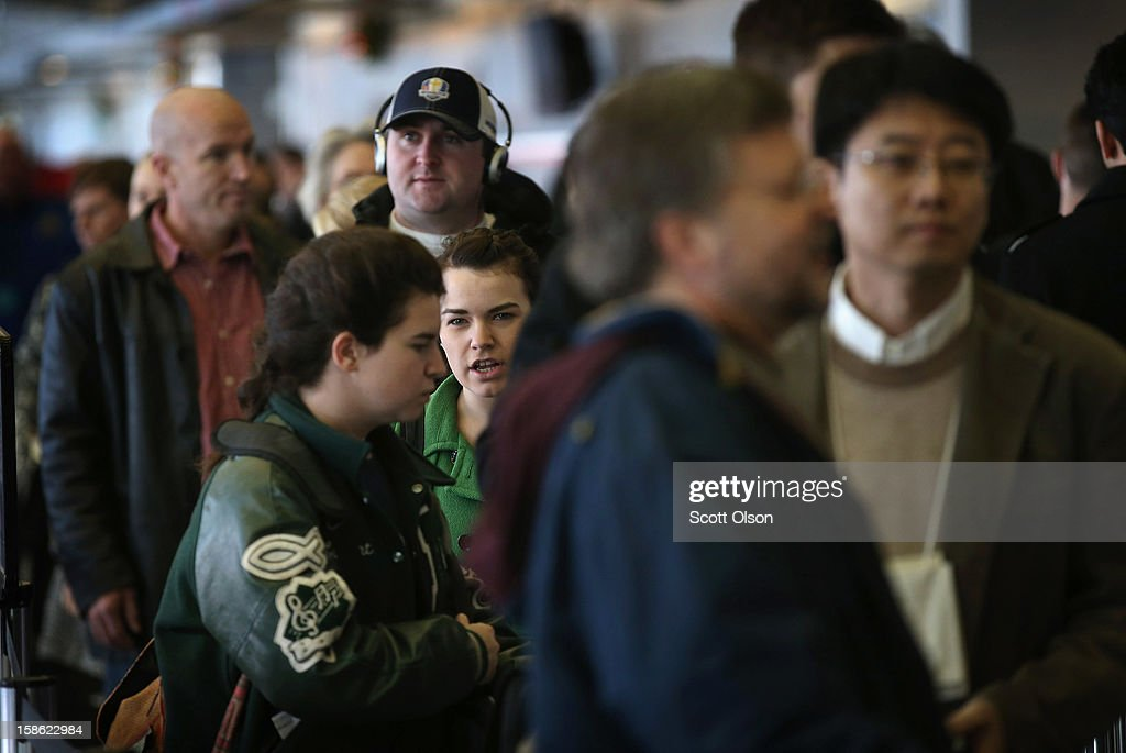 Passengers wait in line to check in for their flights at O'Hare International Airport on December 21, 2012 in Chicago, Illinois. Today is the busiest air travel day of the Christmas holiday, with an estimated 200,000 travelers expected to travel through O'Hare today.