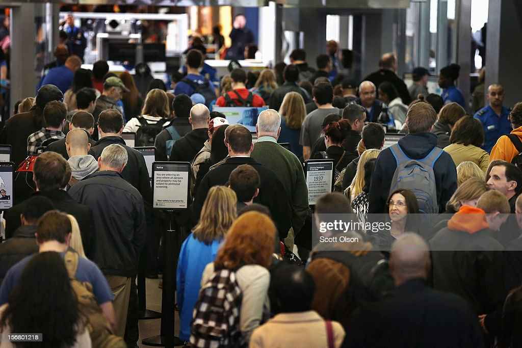 Passengers wait in line to pass through security at O'Hare Airport on November 21, 2012 in Chicago, Illinois. The Chicago Department of Aviation anticipates nearly 1.8 million passengers will travel through Chicago's two airports for the Thanksgiving holiday travel period between Tuesday, November 20 and Tuesday November 27.