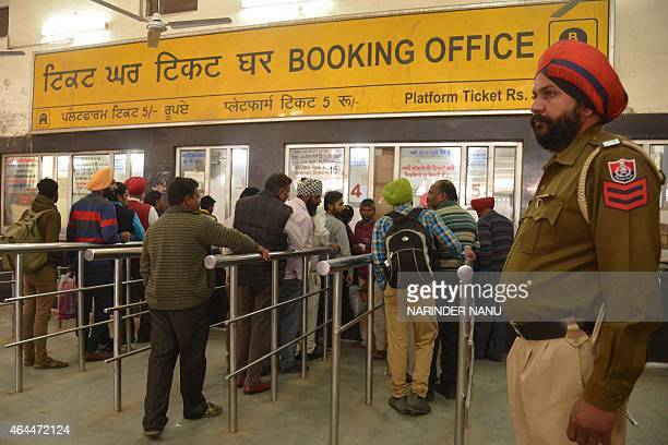Passengers wait in line to purchase train tickets at a railway station in Amritsar on February 26 2015 India said it would spend 137 billion dollars...