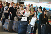 Passengers wait in line to reschedule flights at O'Hare International Airport on September 26 2014 in Chicago Illinois All flights in and out of...