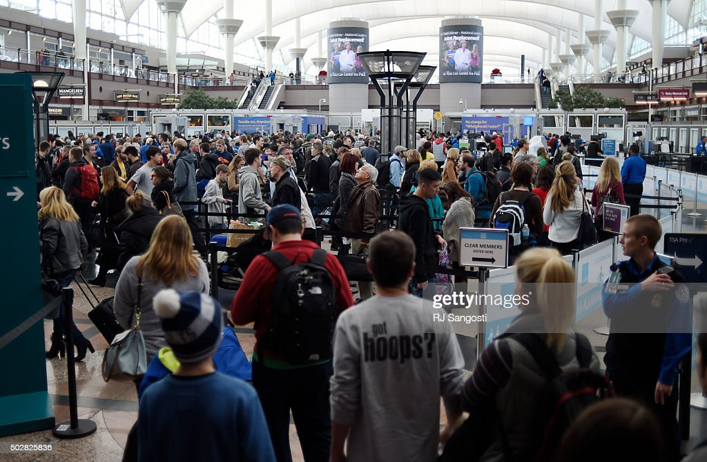 Passengers wait in long security lines at Denver International Airport December 2015 Unusually harsh weather conditions in several regions nationwide...
