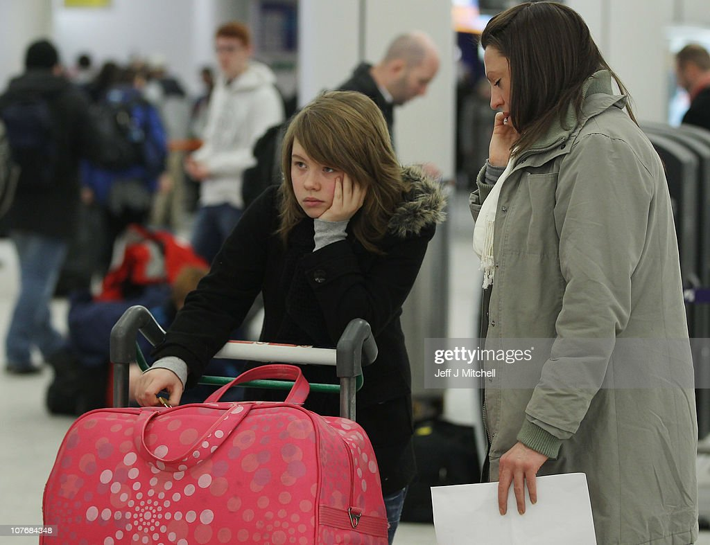 Passengers wait in the airport as they face delays to their flights following disruption due to snow at Edinburgh Airport on December 19, 2010 in Edinburgh, Scotland. The United Kingdom is continuing to suffer heavy snowfall causing delays at many airports and closure of major roads.