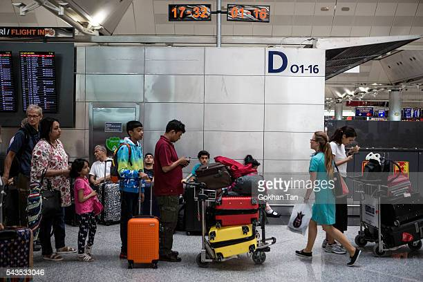 Passengers wait in the checkin counters at the country's largest airport Istanbul Ataturk following yesterday's blast on June 29 2016 in Istanbul...