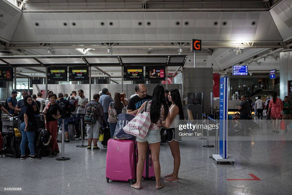 Passengers wait in the check-in counters at the country's largest airport, Istanbul Ataturk, following yesterday's blast on June 29, 2016 in Istanbul, Turkey. Three suicide bombers opened fire before blowing themselves up at the entrance to the main international airport in Istanbul yesterday. The Istanbul Governor's Office says 41 people have been killed, 37 of the victims have been identified, including 10 foreign nationals and three people with dual citizenship. More than 230 people were wounded but 109 have been discharged from hospitals in the deadly suicide bombing attack in Istanbul's Ataturk airport blamed on the Islamic State group.