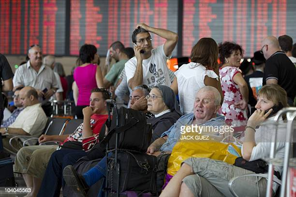 Passengers wait in the departure hall at Israel's Ben Gurion International Airport near Tel Aviv on September 13 as airport staff seeking guarantees...