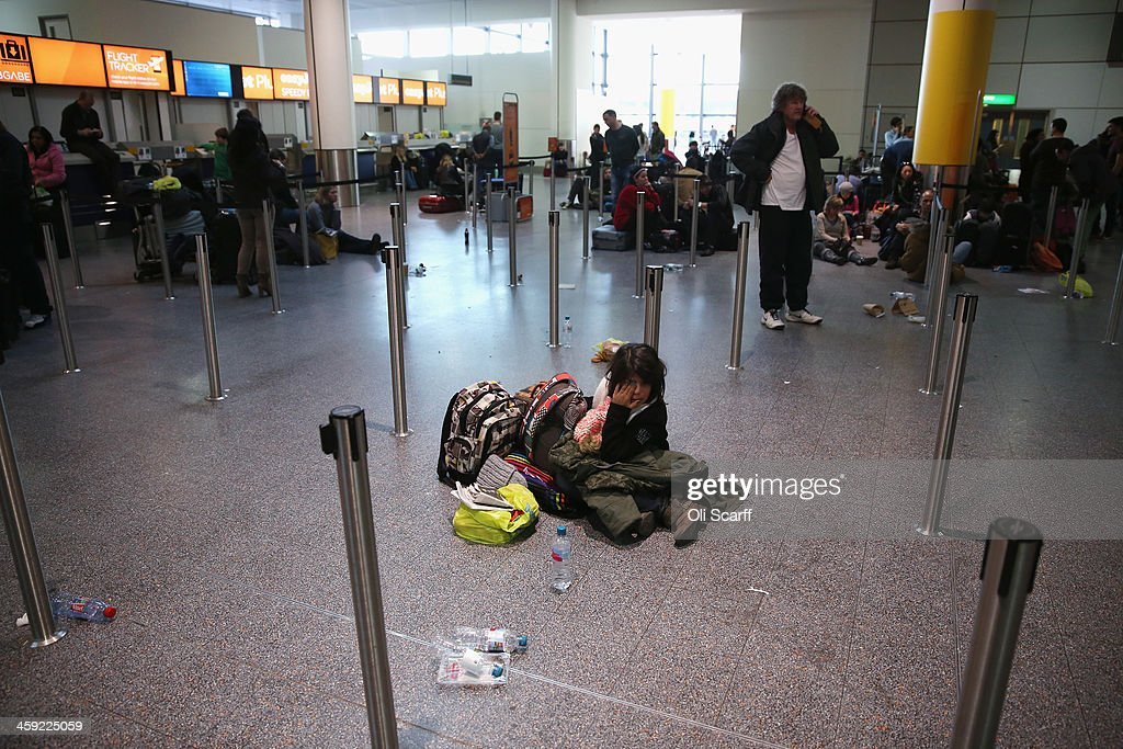 Passengers wait in the departure hall of Gatwick airport's North Terminal as severe weather has caused delays and cancellations to numerous flights from the airport on December 24, 2013 in London, England. Christmas plans have been badly affected for thousands of people after storms across the UK have resulted in flooding, power cuts and significant problems with transport infrastructure.