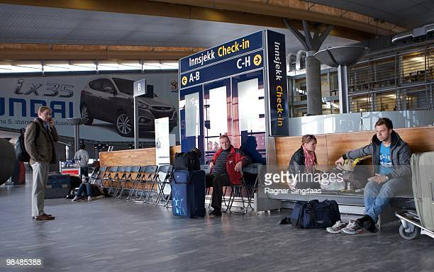 Passengers wait in the departure lounge for information at Oslo Airport Gardermoen on April 15 2010 in Oslo Norway All flights in and out of Norway...