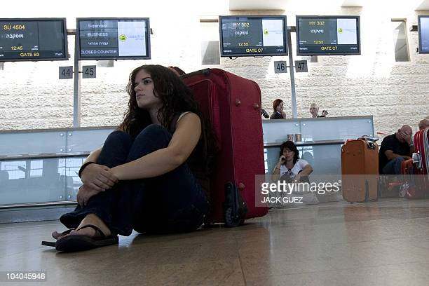 Passengers wait in the departures hall at Israel's Ben Gurion International Airport near Tel Aviv on September 13 as airport staff seeking guarantees...