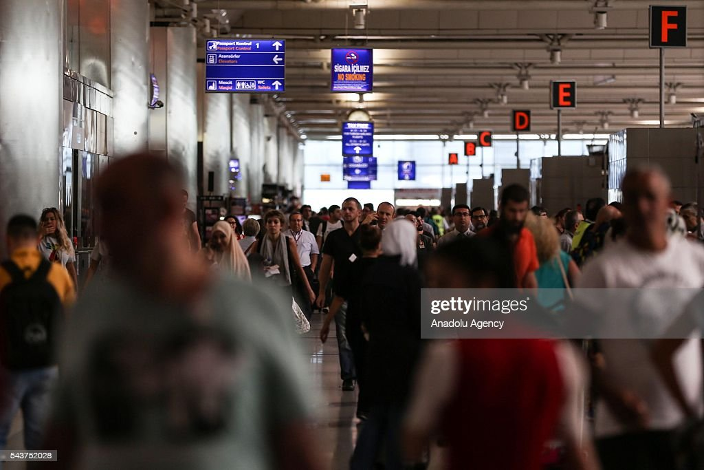 Passengers wait in the queue at passport control points at the Ataturk International Airport after the air traffic returned to normal following terror attack in Istanbul, Turkey on June 30, 2016.