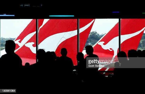 Passengers wait inside the terminal to board their Qantas flights after checking in at Melbourne Airport on October 31 2011 in Melbourne Australia...